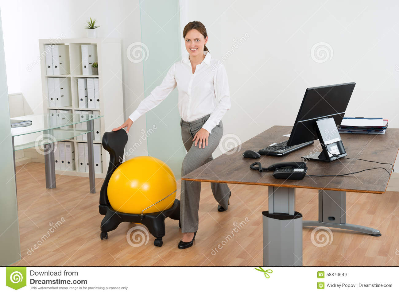 Pilates Ball Chair Businesswoman Exercising With Pilates Ball On Chair Stock Image