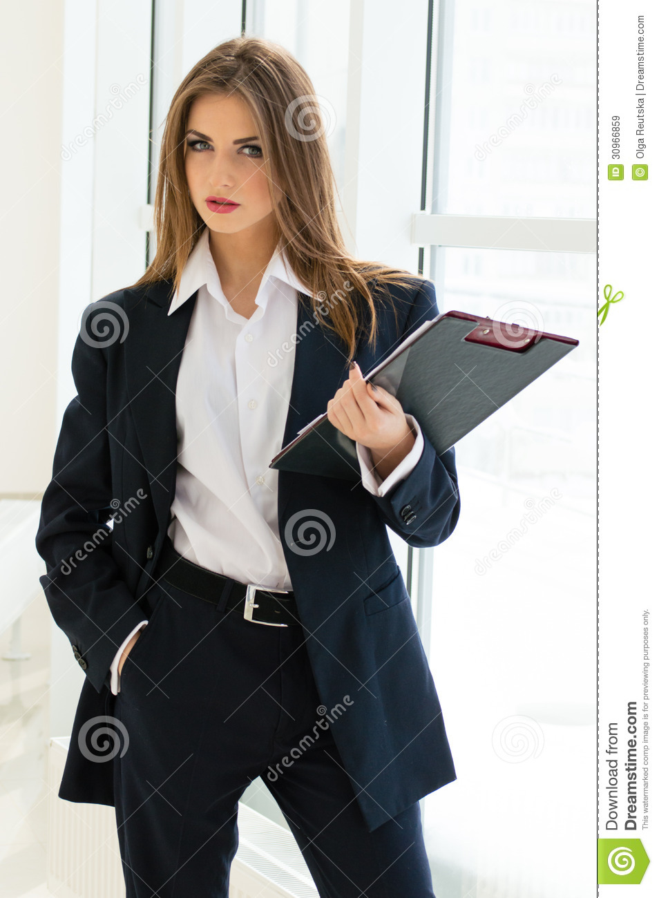 Businesswoman In Mans Suit  Shirt Writing With Pen At