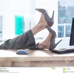 Swivel Chair Feet Covers Elastic Businesswoman Sitting On With Desk Stock Image At The Office