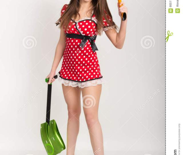 Busty Beautiful Young Girl In A Short Dress With Polka Dots Bear In One Hand