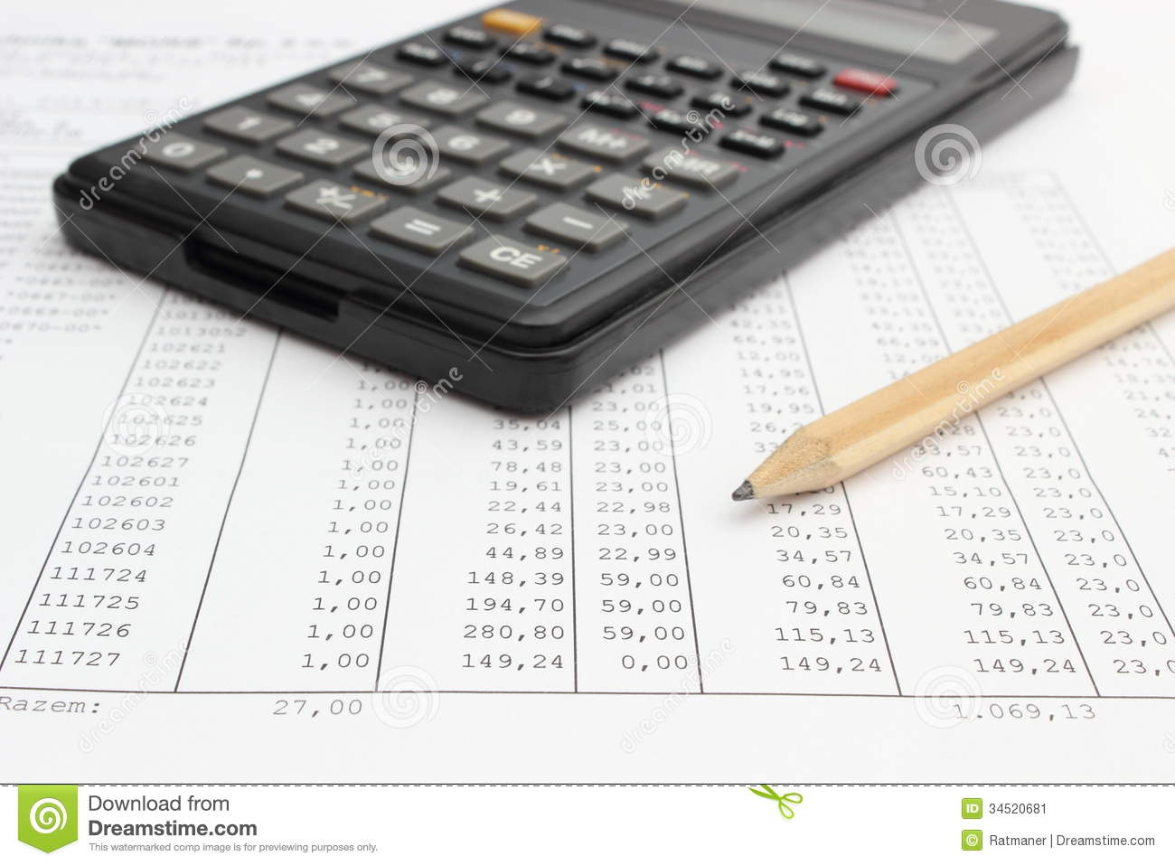 Calculator And Pencil Lying On Spreadsheet Stock Image