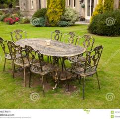 Iron Patio Chair Target Gaming Black Friday Cast Table And Chairs Stock Image. Image Of Bushes - 15716159