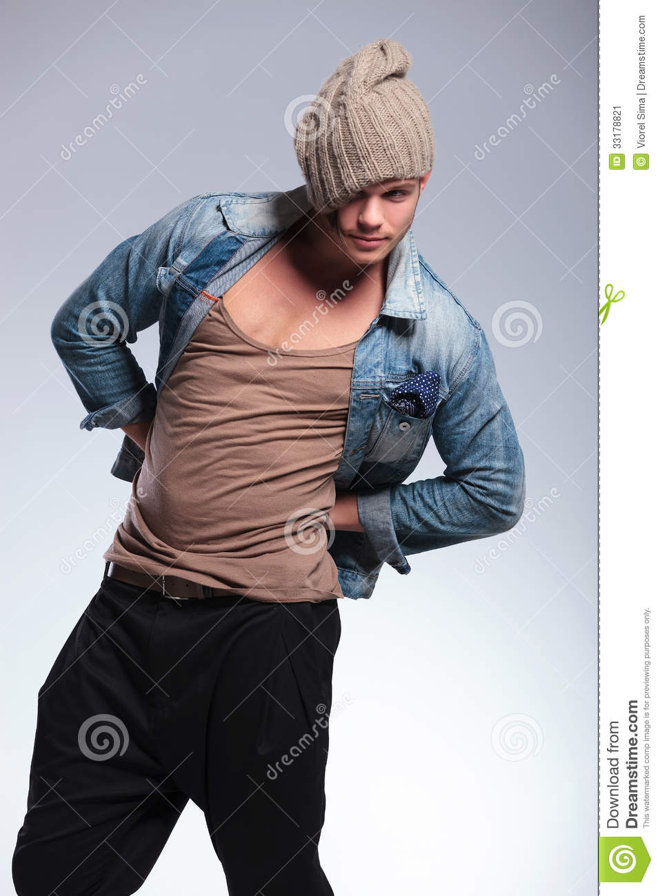 Casual Man With Hands On Hips And Hat Stock Image Image