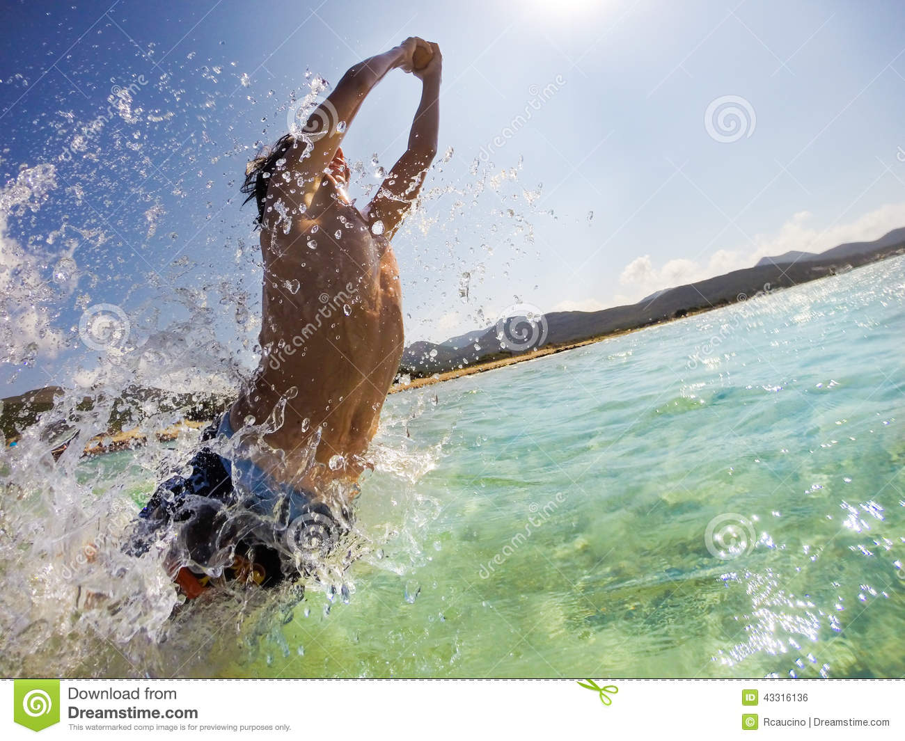 Caucasian Young Boy Jumping In Water Playing And Having