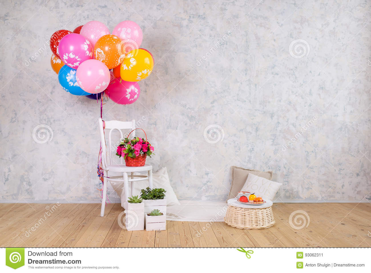 chair with balloons floor futon and flowers basket cake stock image of