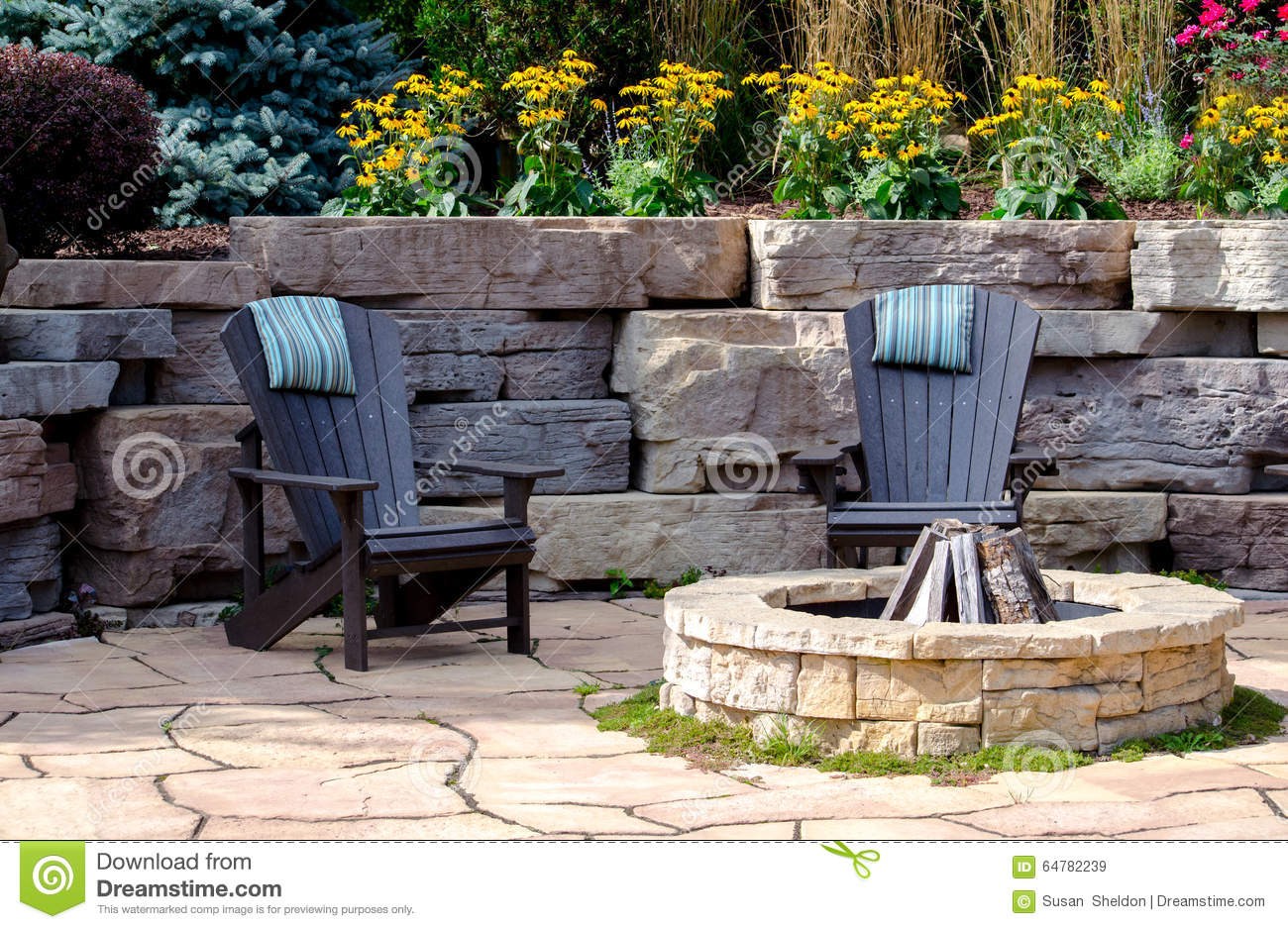 wood adirondack chairs plans 1970 kitchen table and fire-pit patio stock photo - image: 64782239