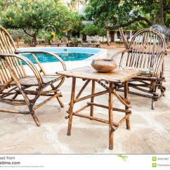 What Are Pool Chairs Made Out Of Wheelchair Dog On Swimming Border Stock Image Outdoor Elegant Wood Close To A Inside Kenyan Garden