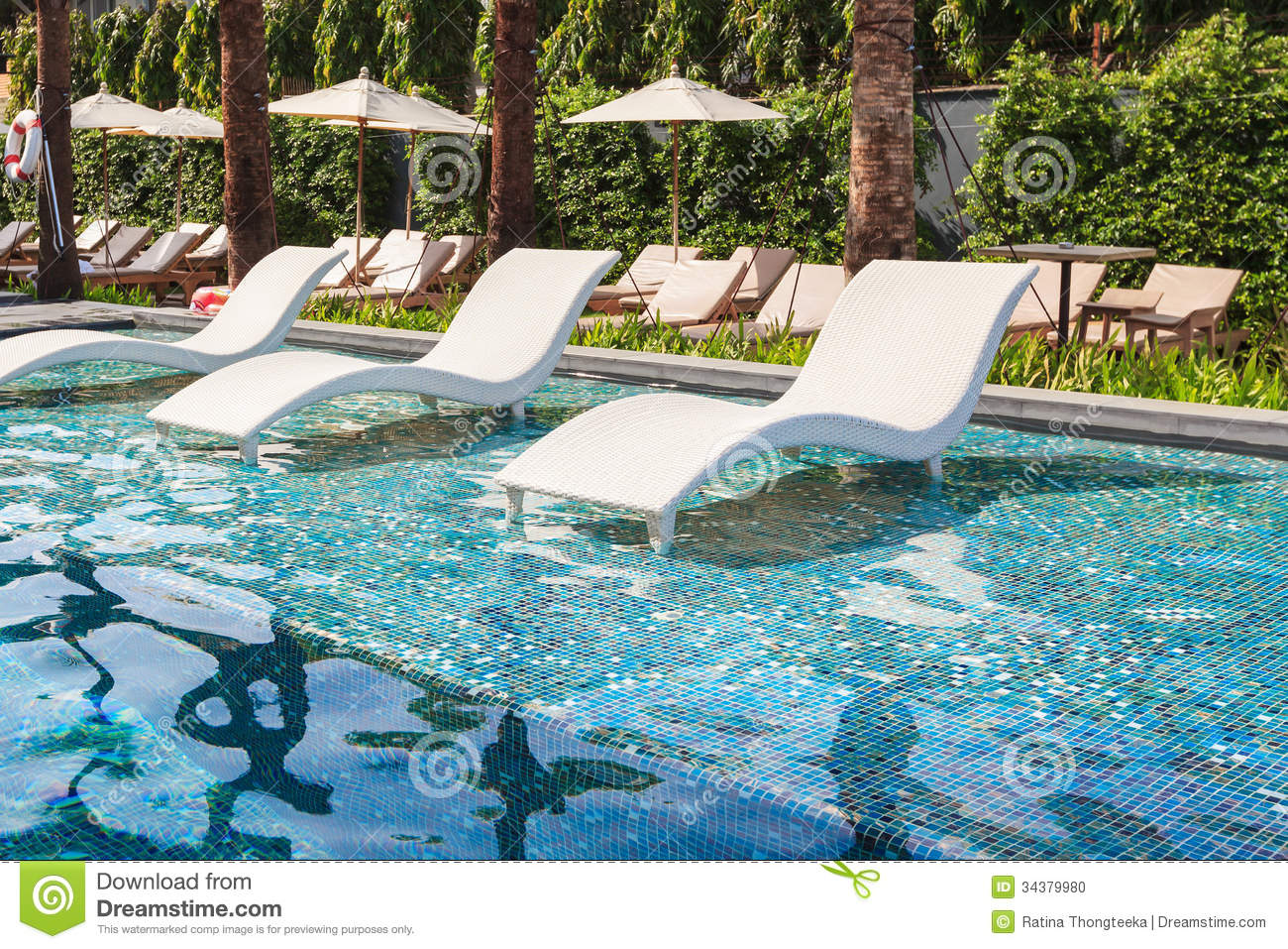 Chaise Lounge In Swimming Pool Stock Photo  Image of
