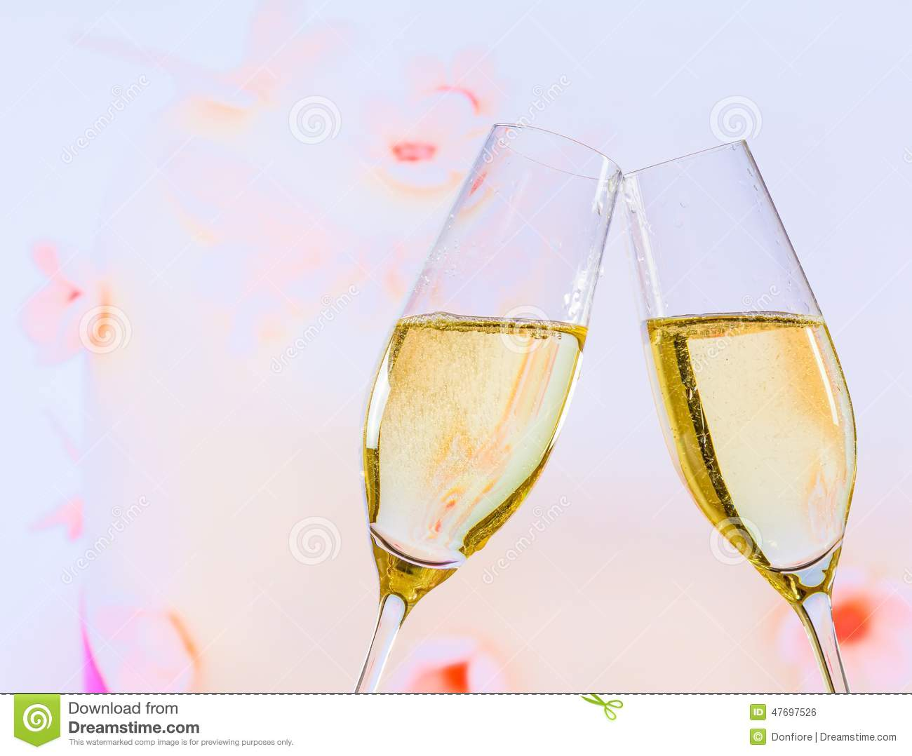 Champagne Flutes With Golden Bubbles On Wedding Cake