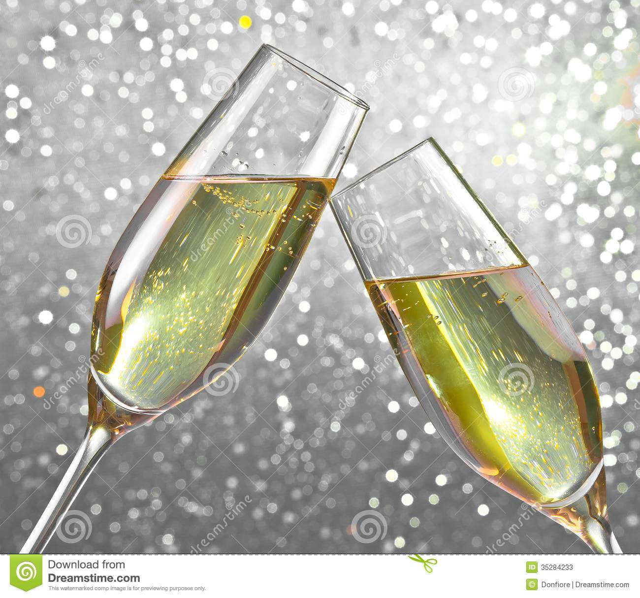 Champagne Flutes On Silver Light Bokeh Background Stock