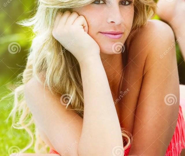 Charming Blonde Girl In Swimsuit Bikini Lying Down On Her Stomach