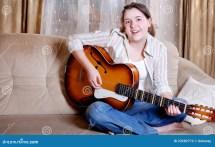 Charming Teenage Girl Play Guitar Stock