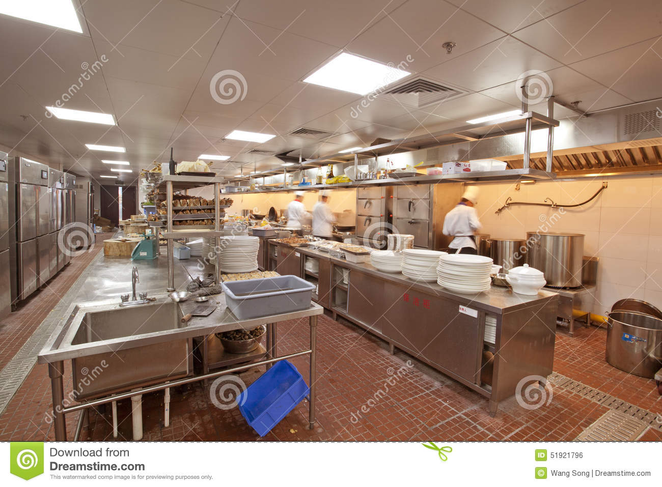 Chef Cooking At Commercial Kitchen Stock Photo  Image