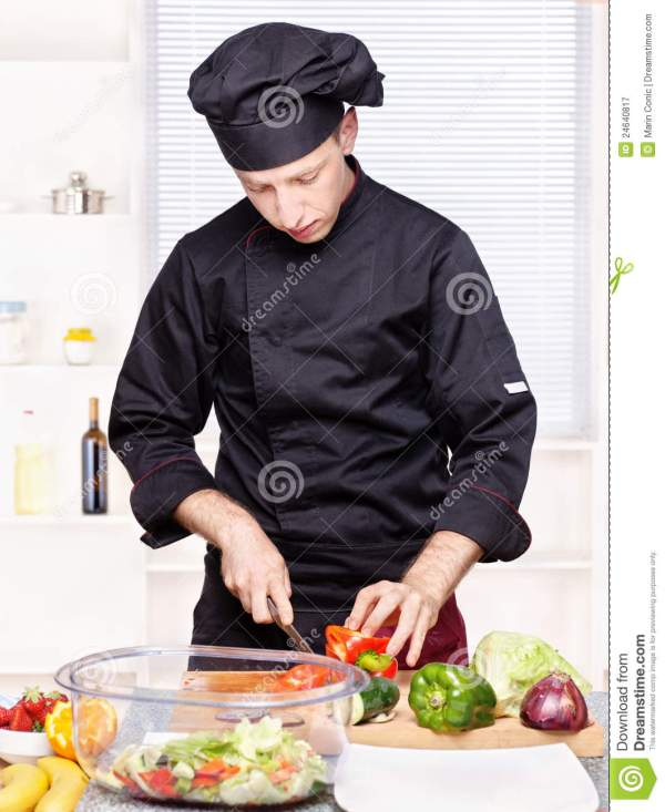 Chef Cutting Bell Peppers In Kitchen Royalty Free Stock