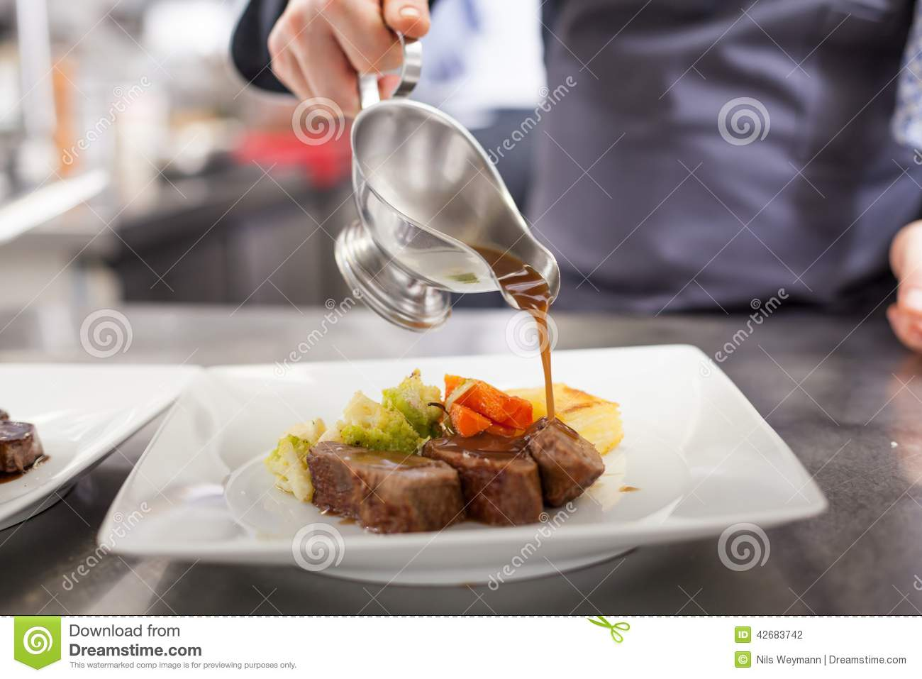 Chef Plating Up Food In A Restaurant Stock Photo  Image