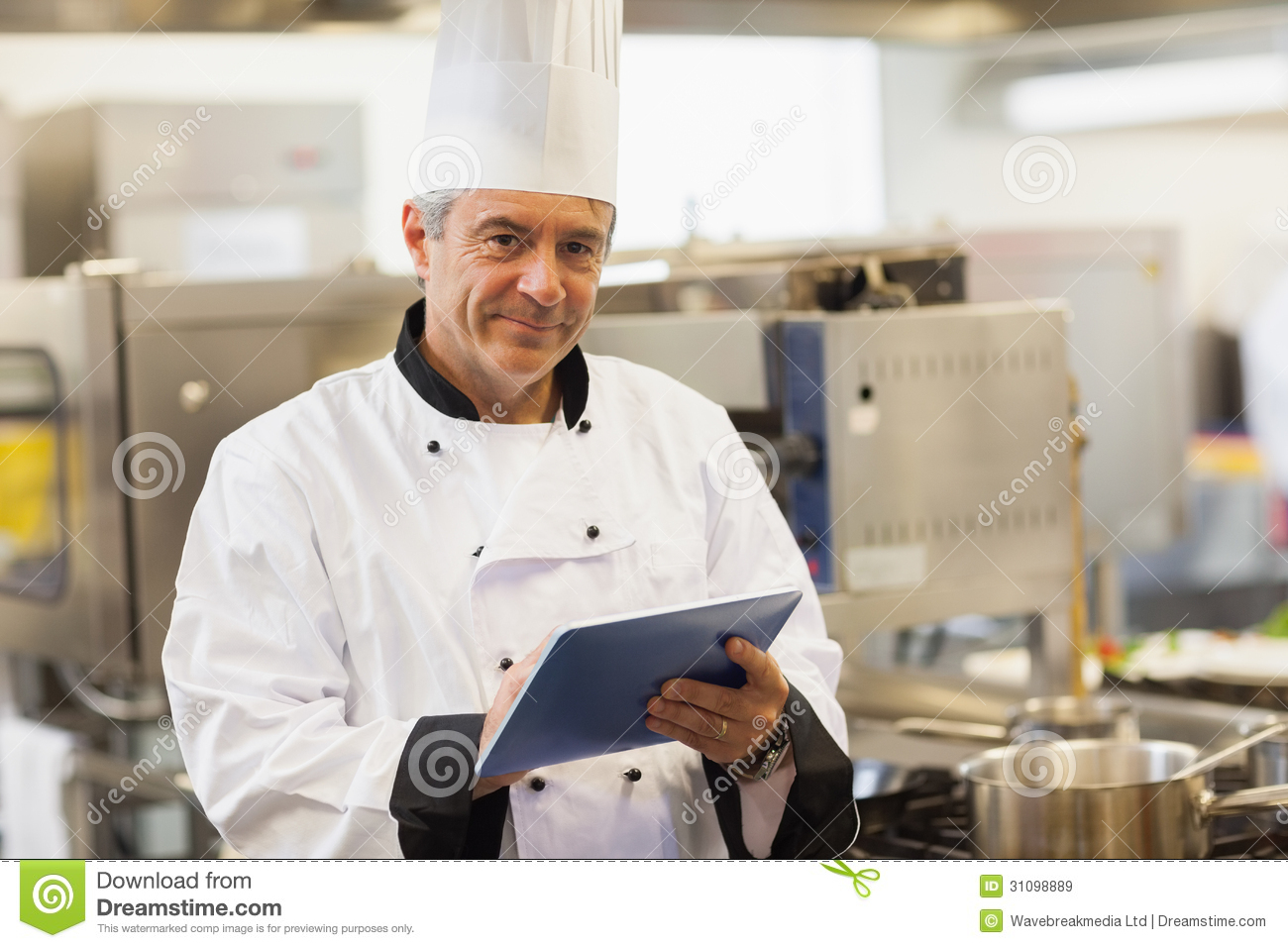 kitchen inventory app ikea faucets chef using his digital tablet and looking at camera