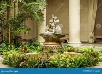 Cherub Fountain in Garden stock photo. Image of museum