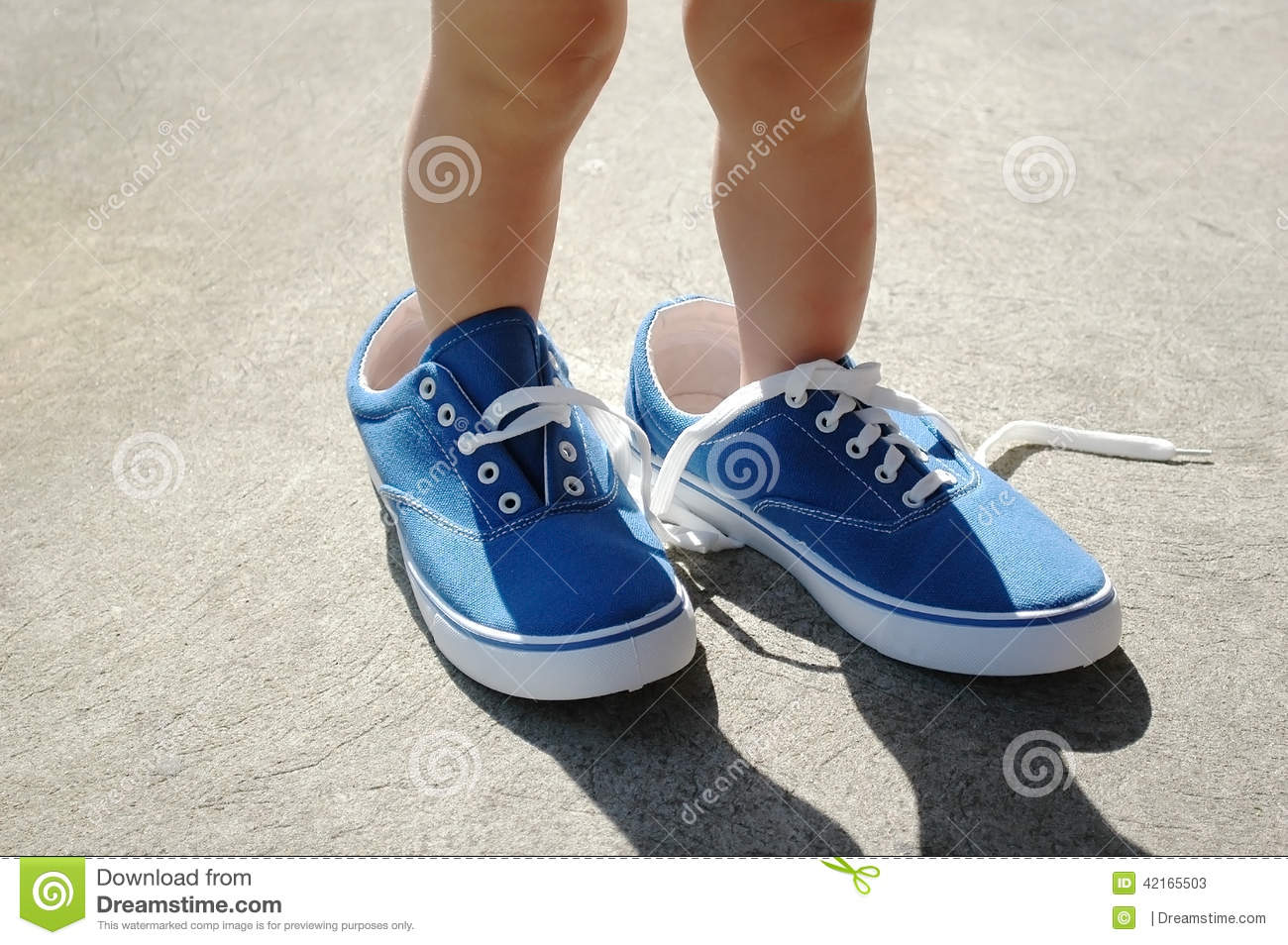 Child In Adults Blue Shoes Stock Photo  Image 42165503
