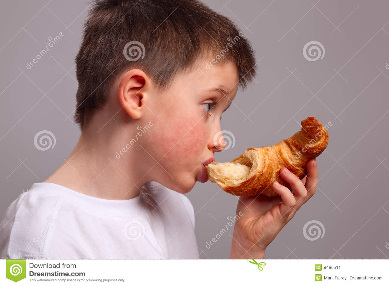 Child Eating A Croissant Stock Image Image 8486511