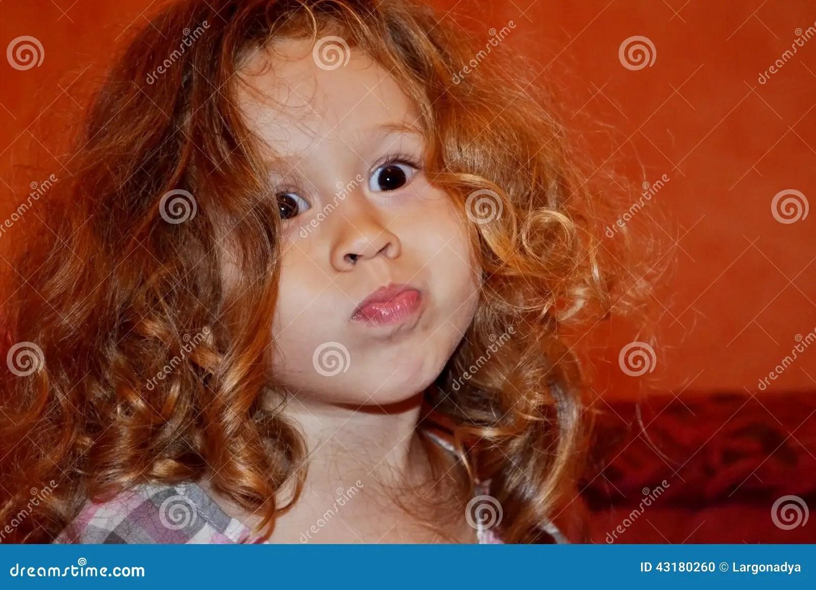 Child Grimaces. Stock Photo - Image: 43180260