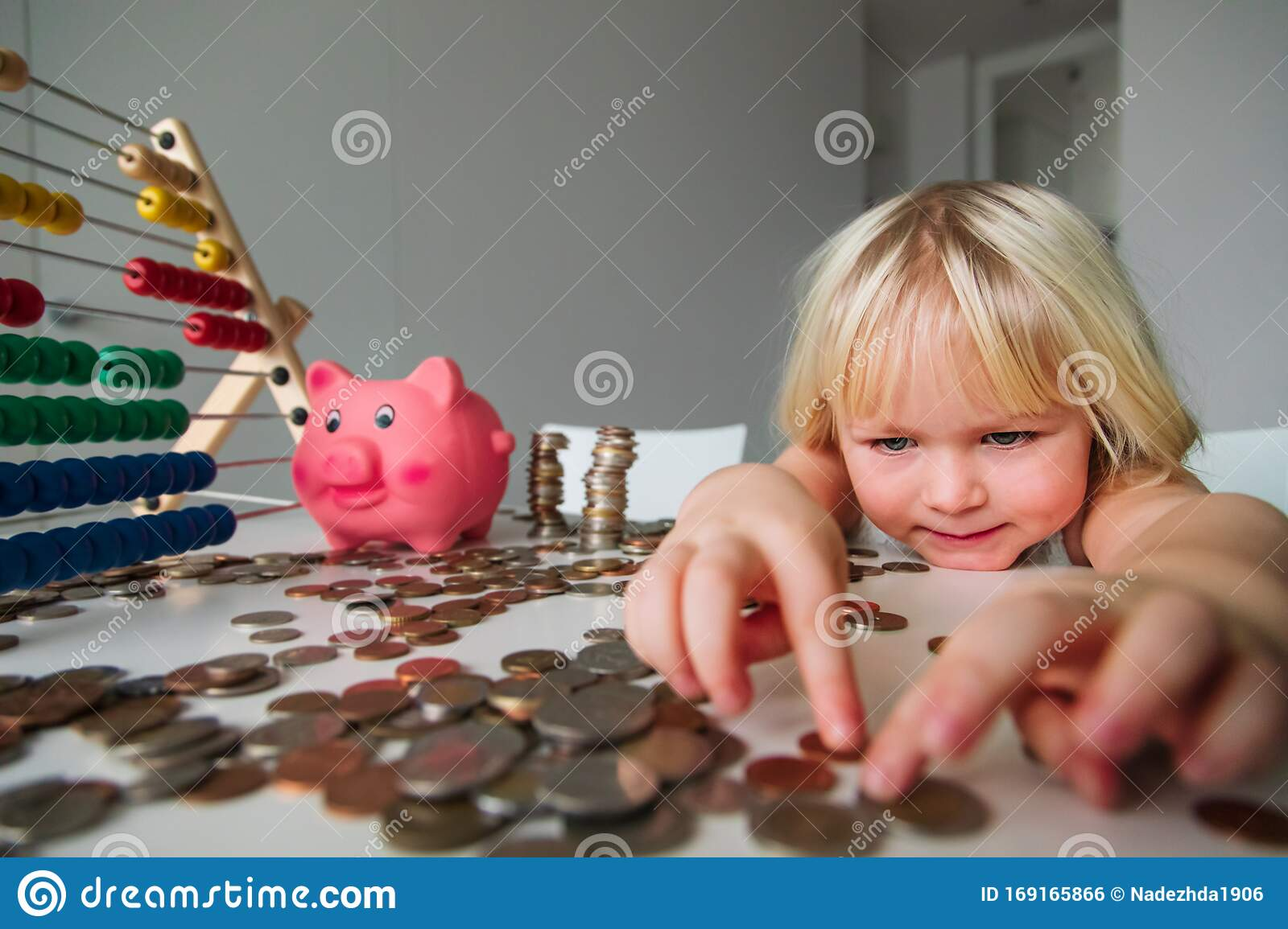 Child Counting Coins And Saving Money Cute Girl Put Coins