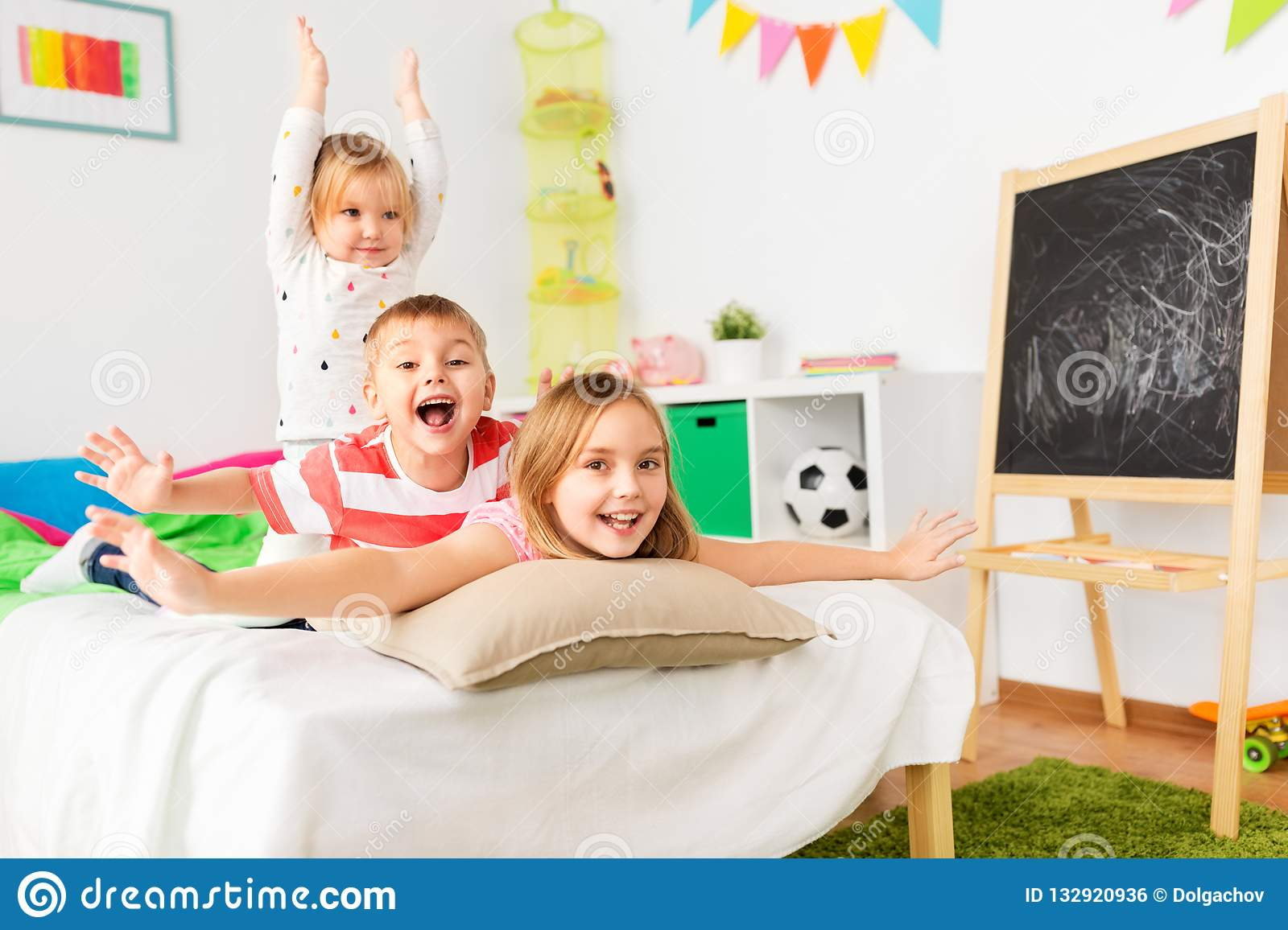 Happy Little Kids Having Fun In Bed At Home Stock Photo ...