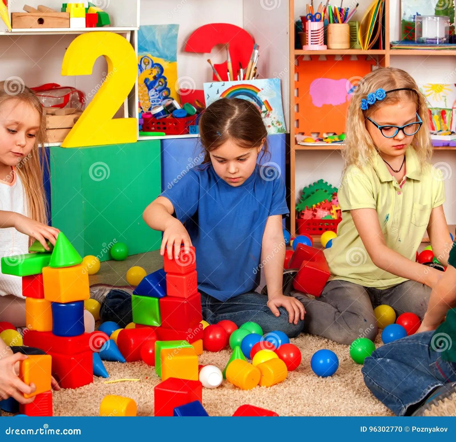 Children Building Blocks In Kindergarten Group Kids