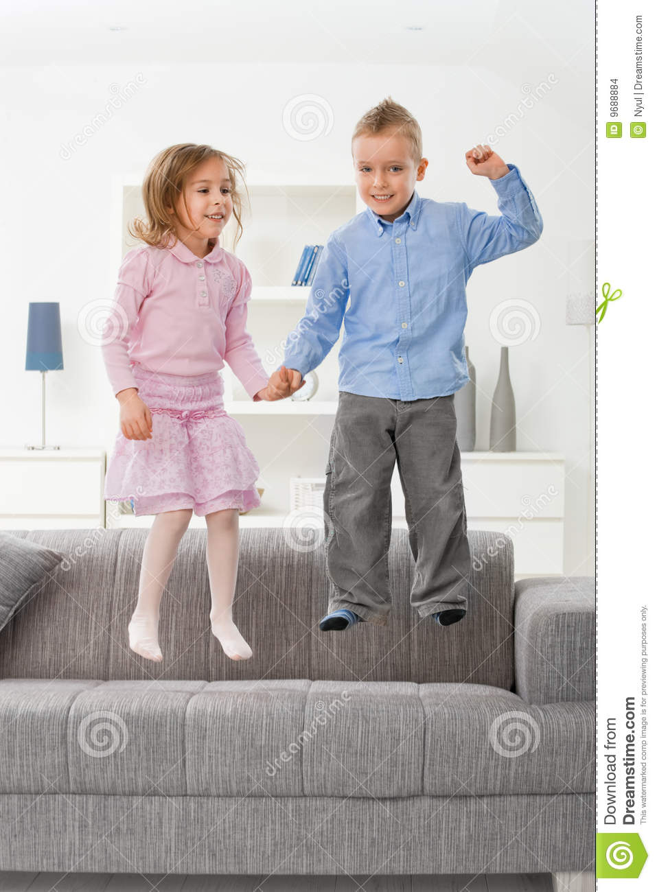 Children Jumping On Couch Stock Images Image 9688884