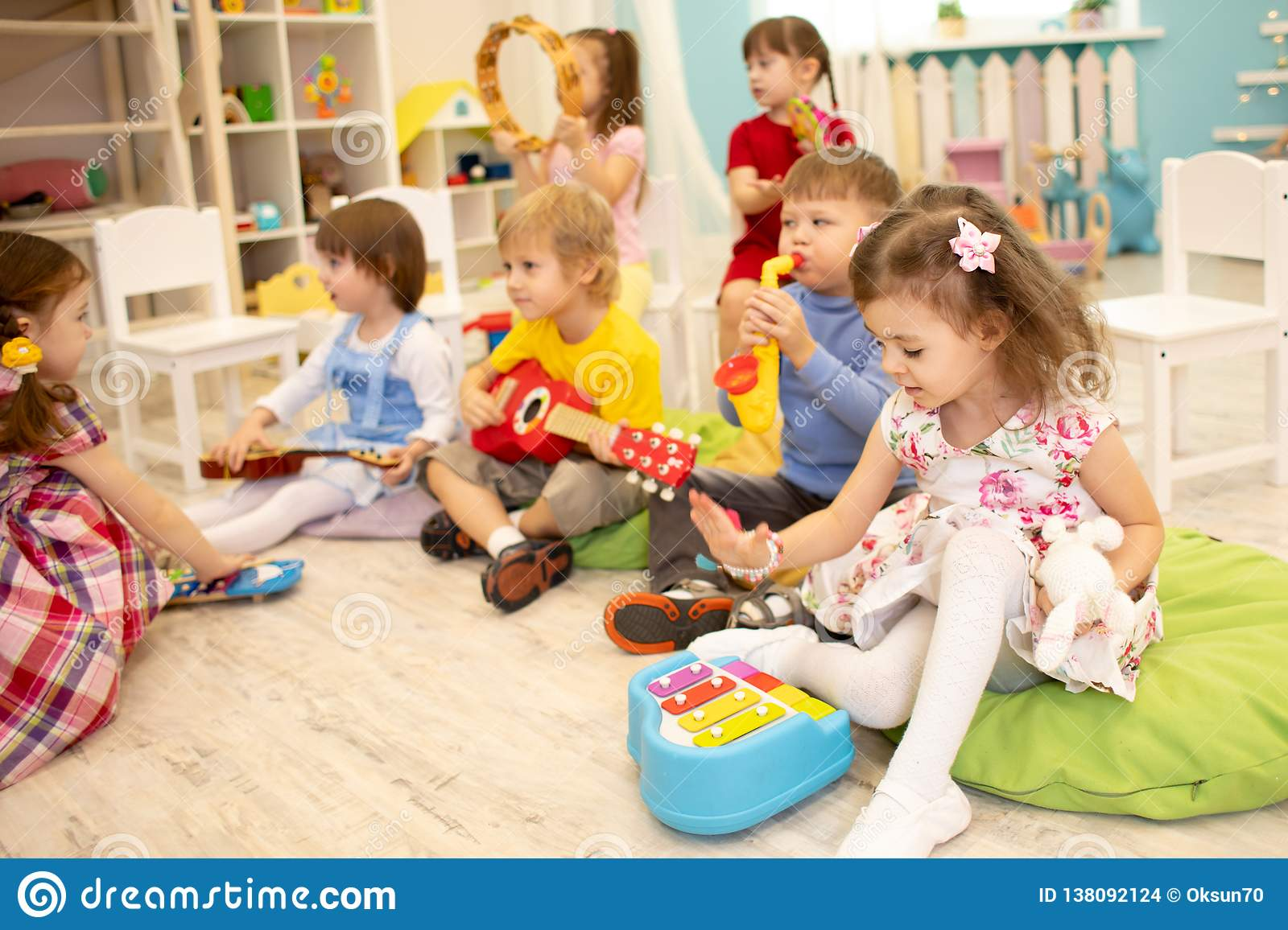 Children Learning Musical Instruments On Lesson In