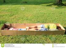 Children Sleeping In Box Stock - 42630721