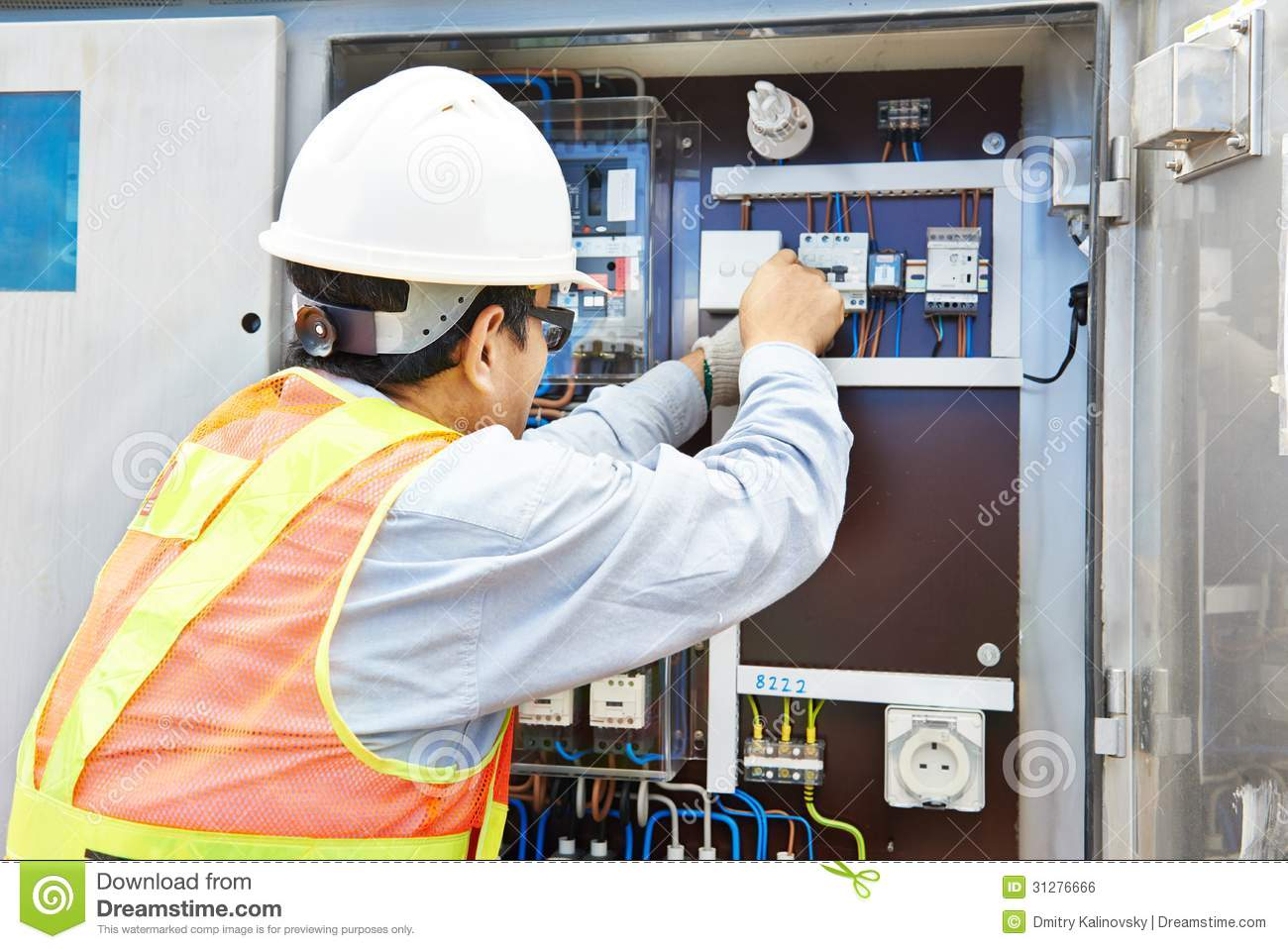 hight resolution of one chinese electrician builder at work with high voltage power electric line distribution fuseboard