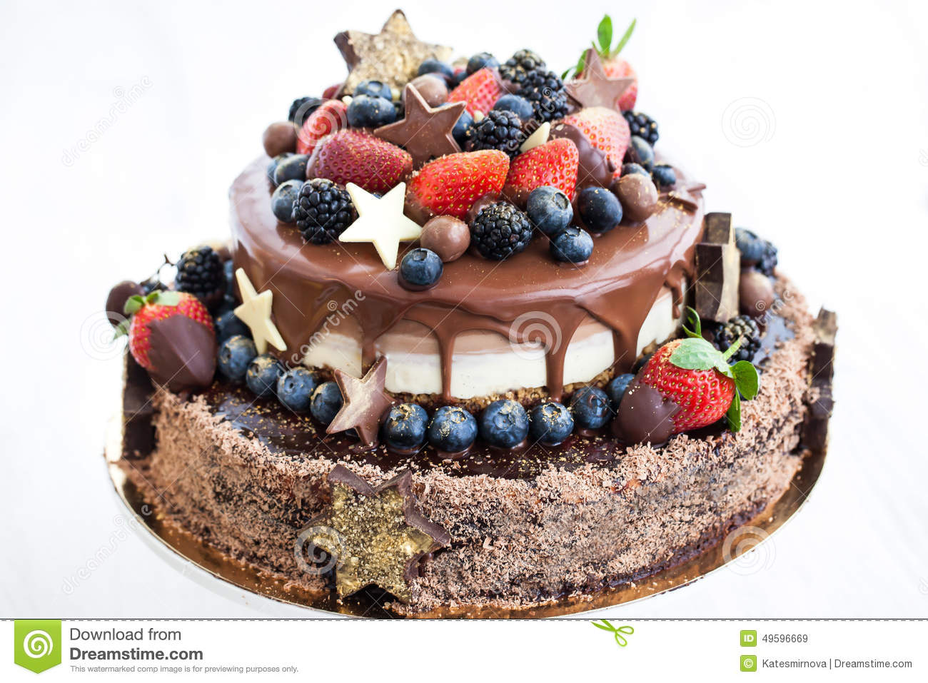 Chocolate Cake With Icing Decorated With Fresh Fruit