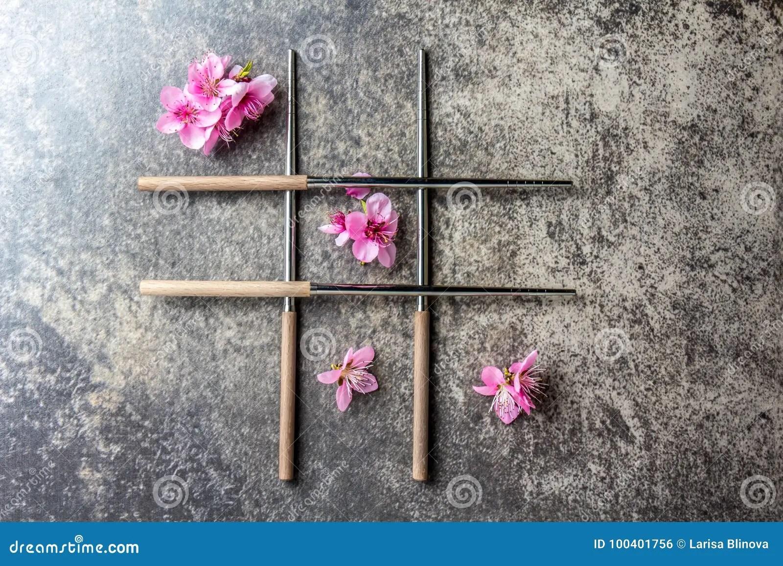 chopsticks and sakura flowers