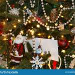 Christmas Background Of Old Fashioned Tree With An Eclectic Variety Of Ornaments Including Santa And Pearl Garland And A Gift Enve Stock Image Image Of Envelope Blurred 133387915