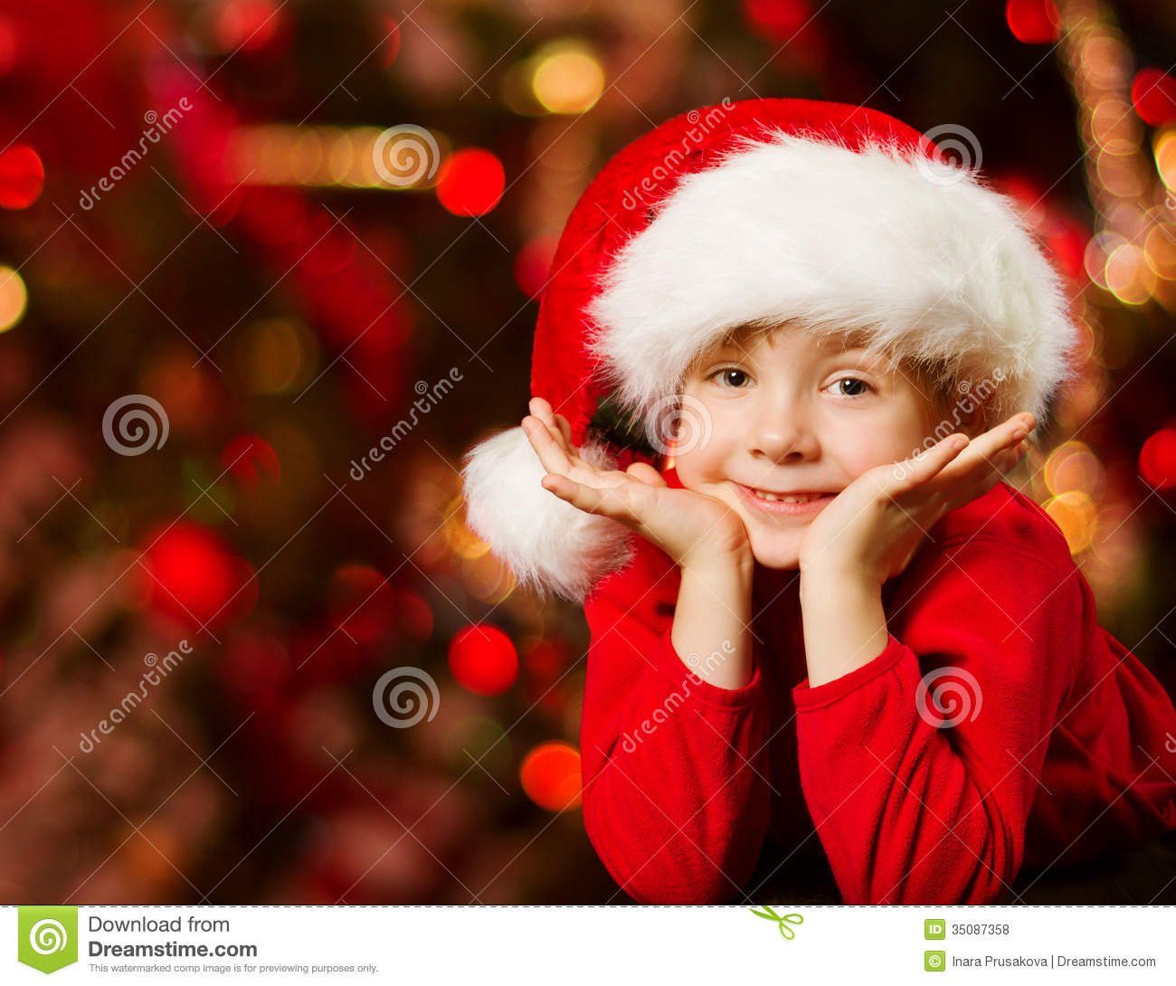 Cute Girl Child Wallpapers Free Download Christmas Child In Santa Hat Smiling Over Red Royalty Free