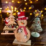 Christmas Decorations Against Blurred Background Small Wooden Snowman Stock Image Image Of Christmas Postcard 161250677