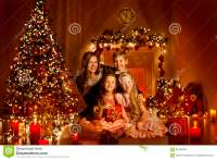 Christmas Family In Decorated Home Room, Christmas Tree ...