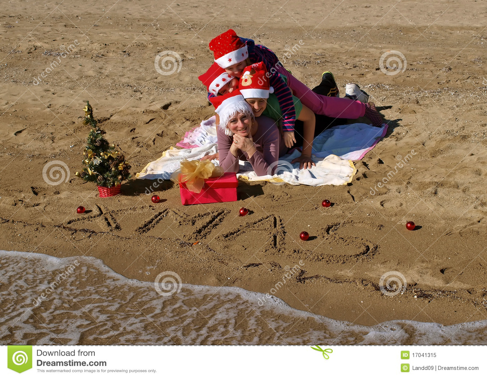 Christmas Family At Sand Beach Royalty Free Stock Photo