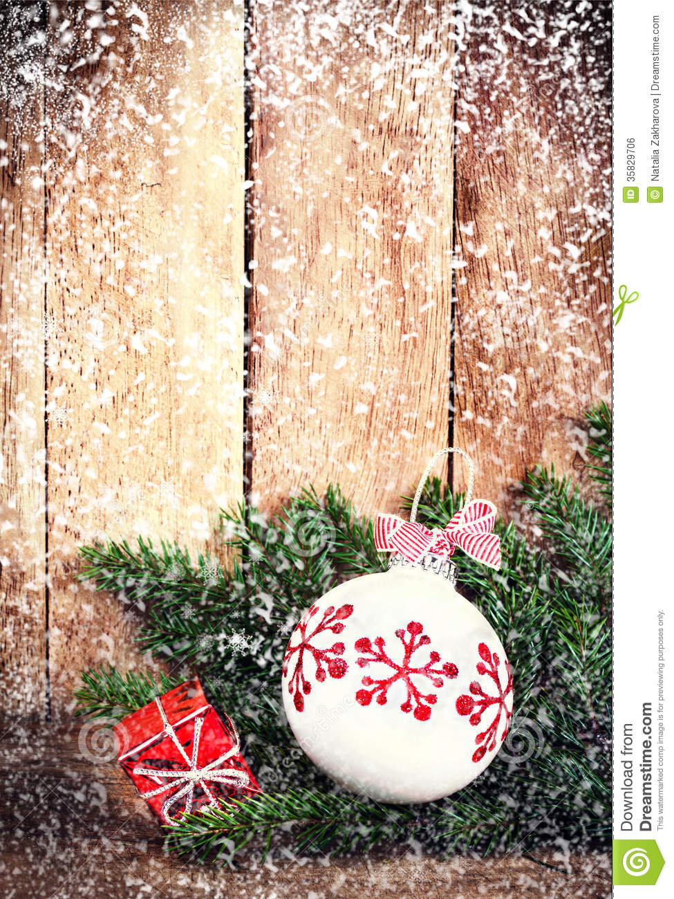 Free Download Of Christmas Wallpaper With Snow Falling Christmas Ornaments With Fir Tree Branch Over Wood Wall
