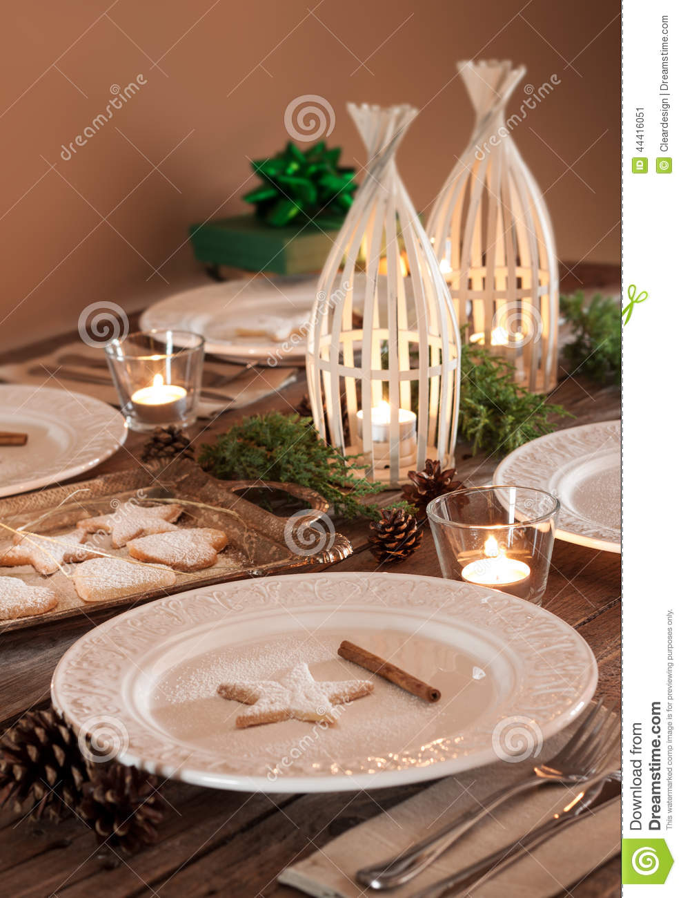 stock photo christmas table setting rustic style natural decorations elegant white plates cookies pine tree branch pinecones candles