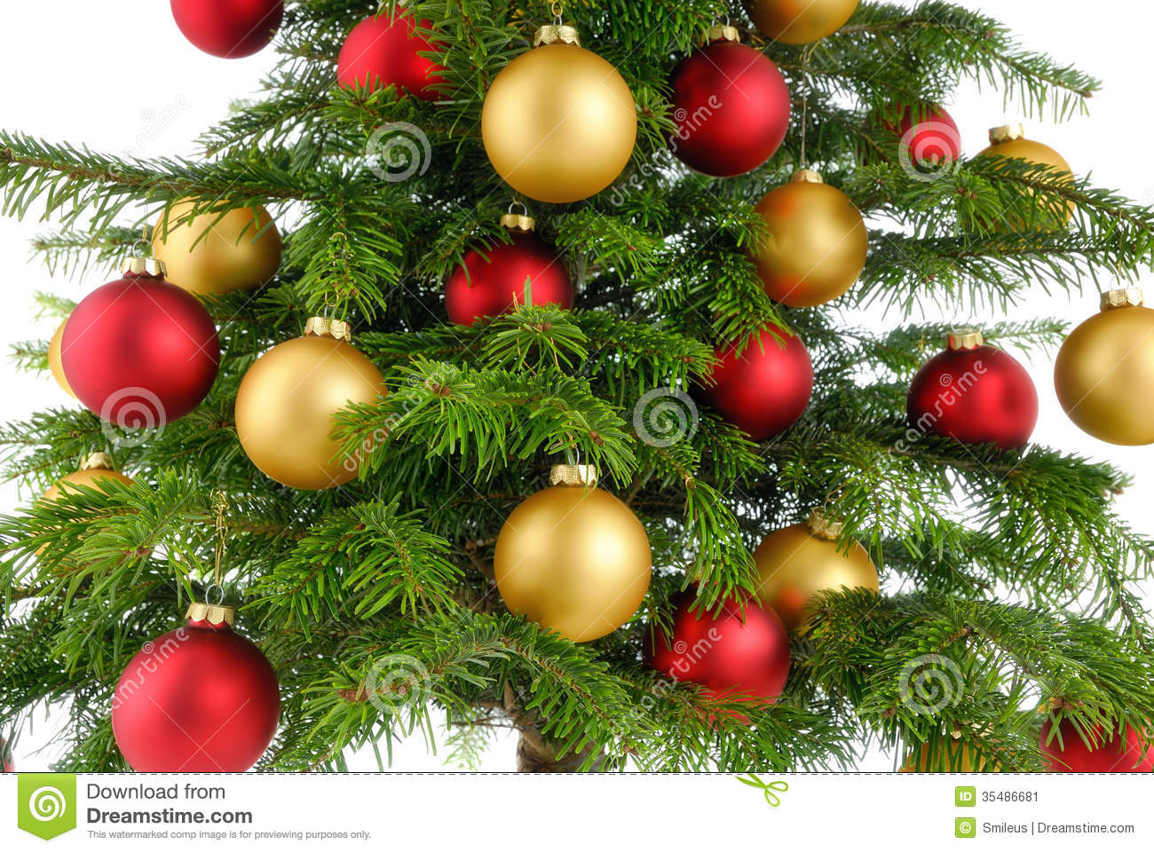 stock christmas tree closeup studio decorated red gold baubles