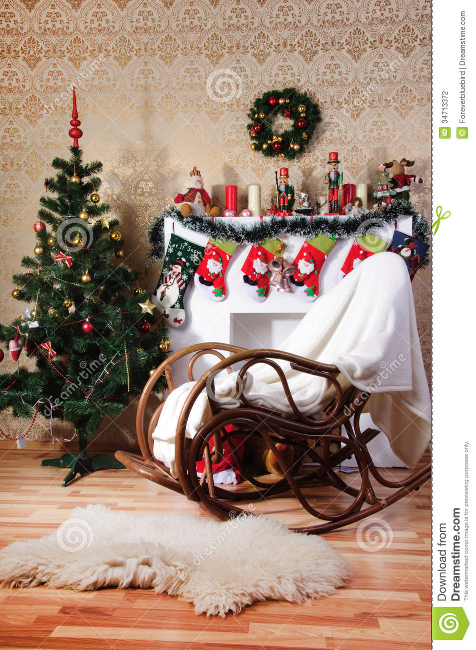 Christmas Tree Decorated Fireplace And Rockingchair In