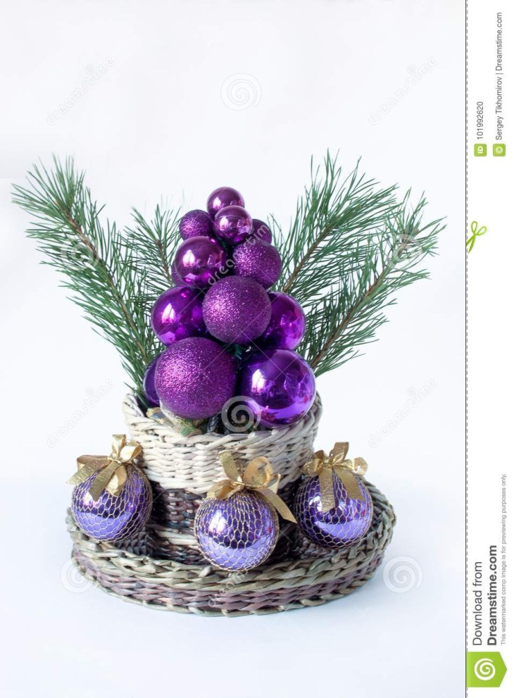 Christmas tree, sprigs of pine and balls for decoration.