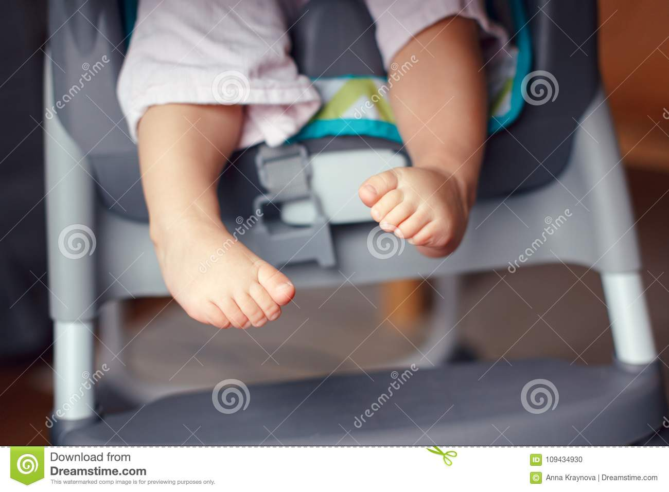 high chairs for small babies patio swivel canada chubby baby legs feet kid sitting in chair stock photo