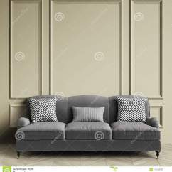 Sofa Gray Color Chairs Toronto Classic Pillows With Geometic Black And White Print Standing In Interior Warm Grey Walls Mouldings Floor Parquet Oak