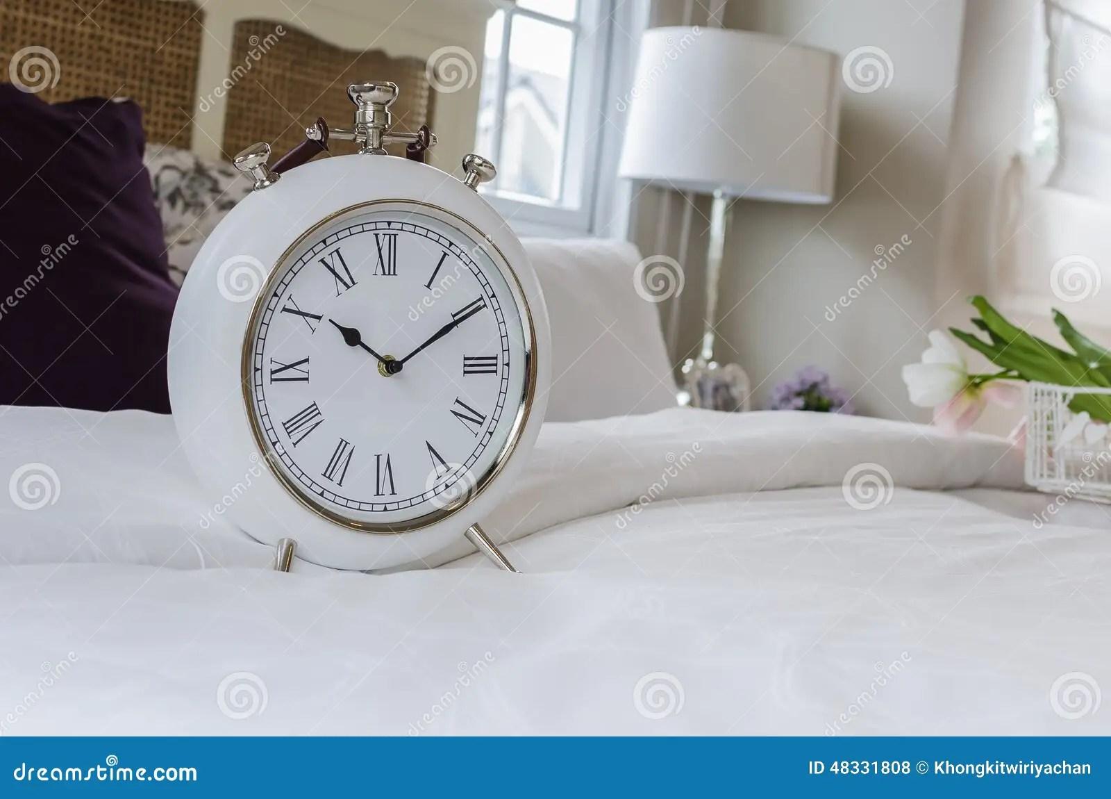 Alarm-clock In Morning Bedroom Royalty-Free Stock Photo