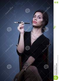 Classy young woman smoking stock photo. Image of slim ...