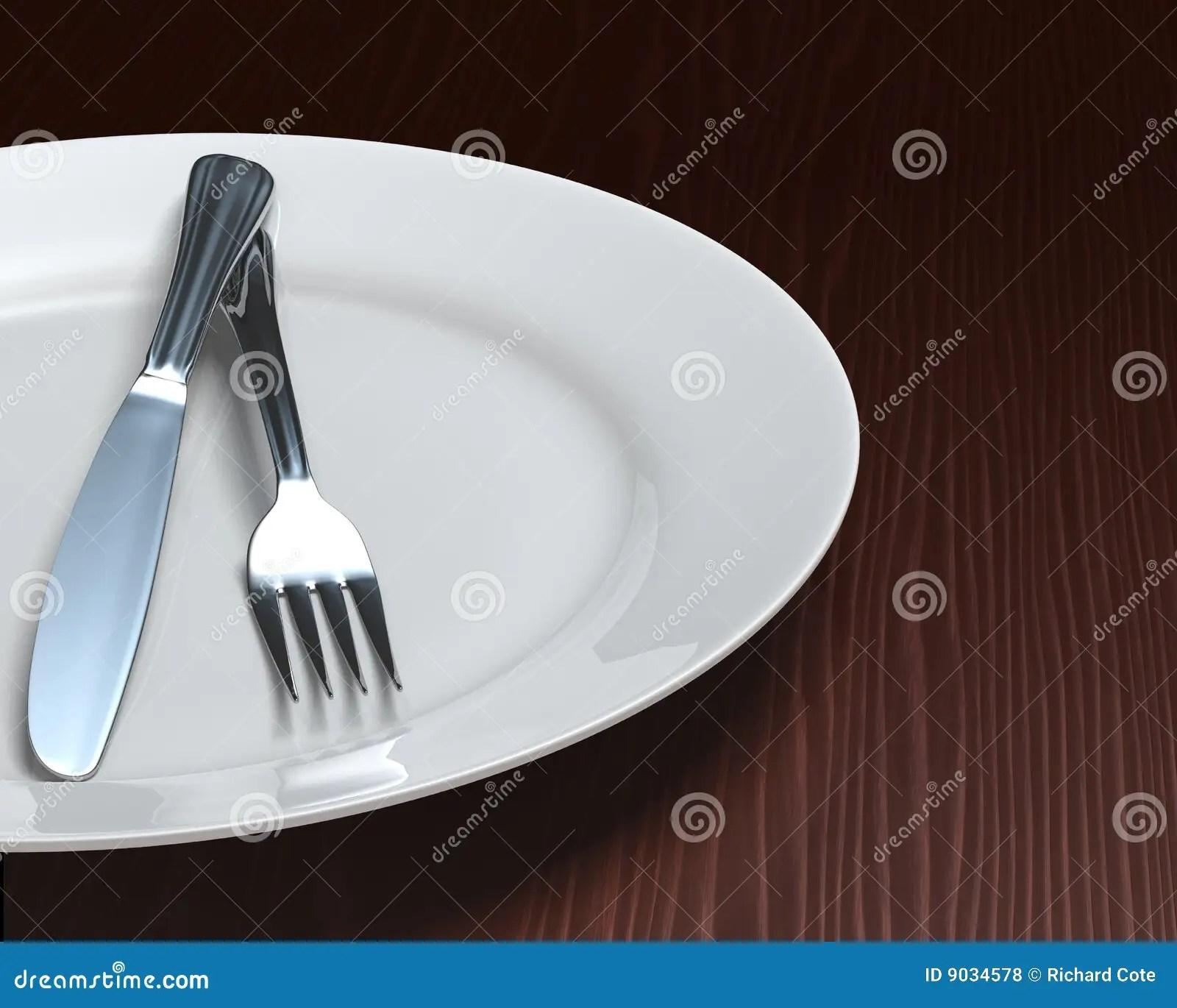 Clean Plate  Cutlery On Dark Woodgrain Table Royalty Free