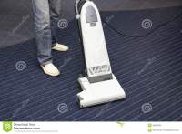 Cleaning The Carpet Vacuum Cleaner Royalty Free Stock ...