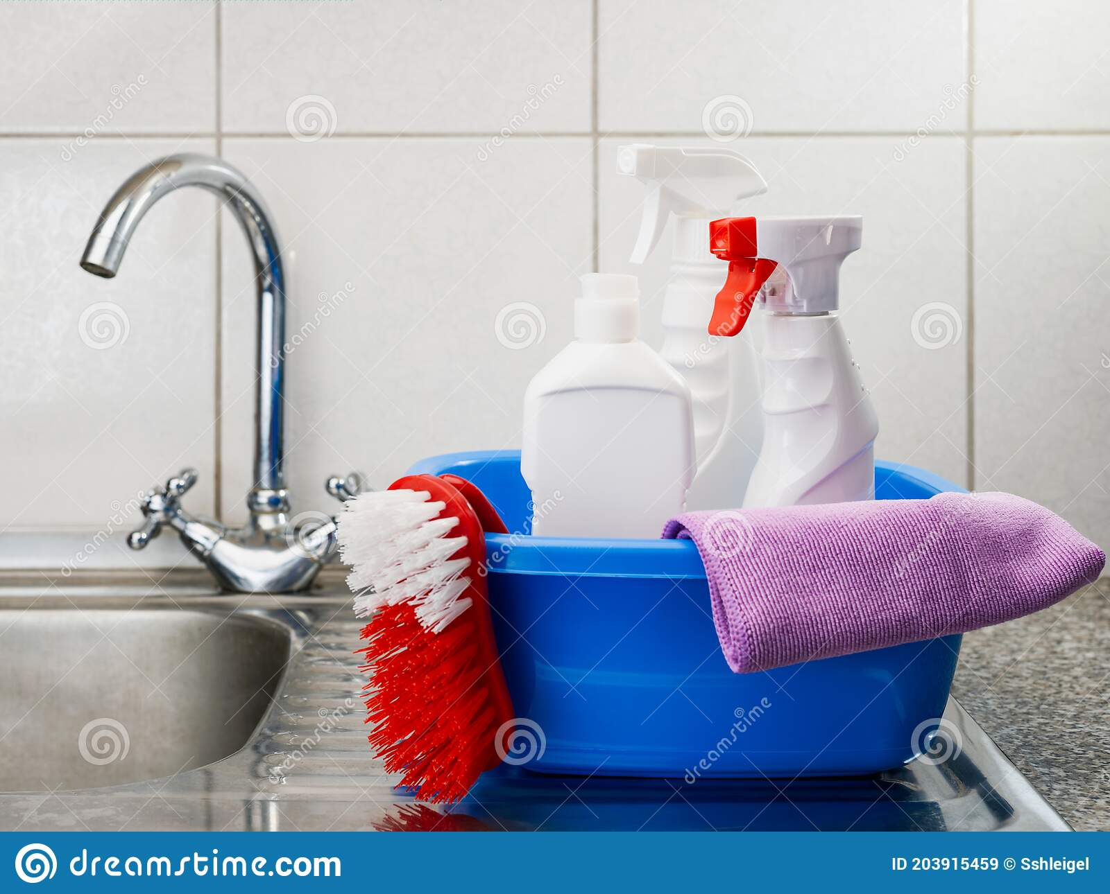 cleaning products in a basin on a kitchen sink stock image image of messy mess 203915459